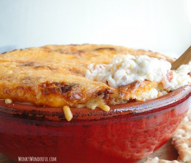 Jalapeno Popper Dip with a golden brown cheesy top and creamy dip inside