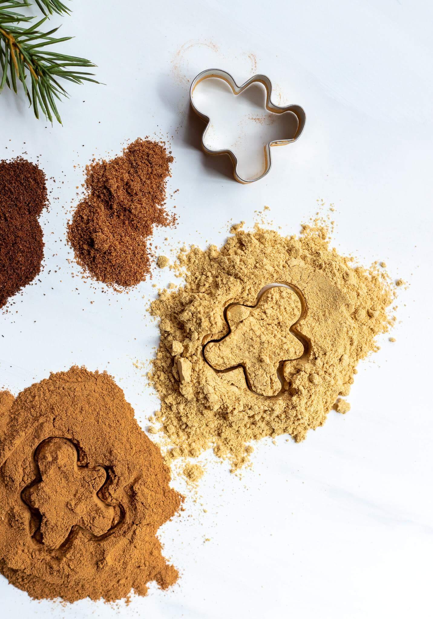 gingerbread spice mix alongside a mini gingerbread man cookie cutter