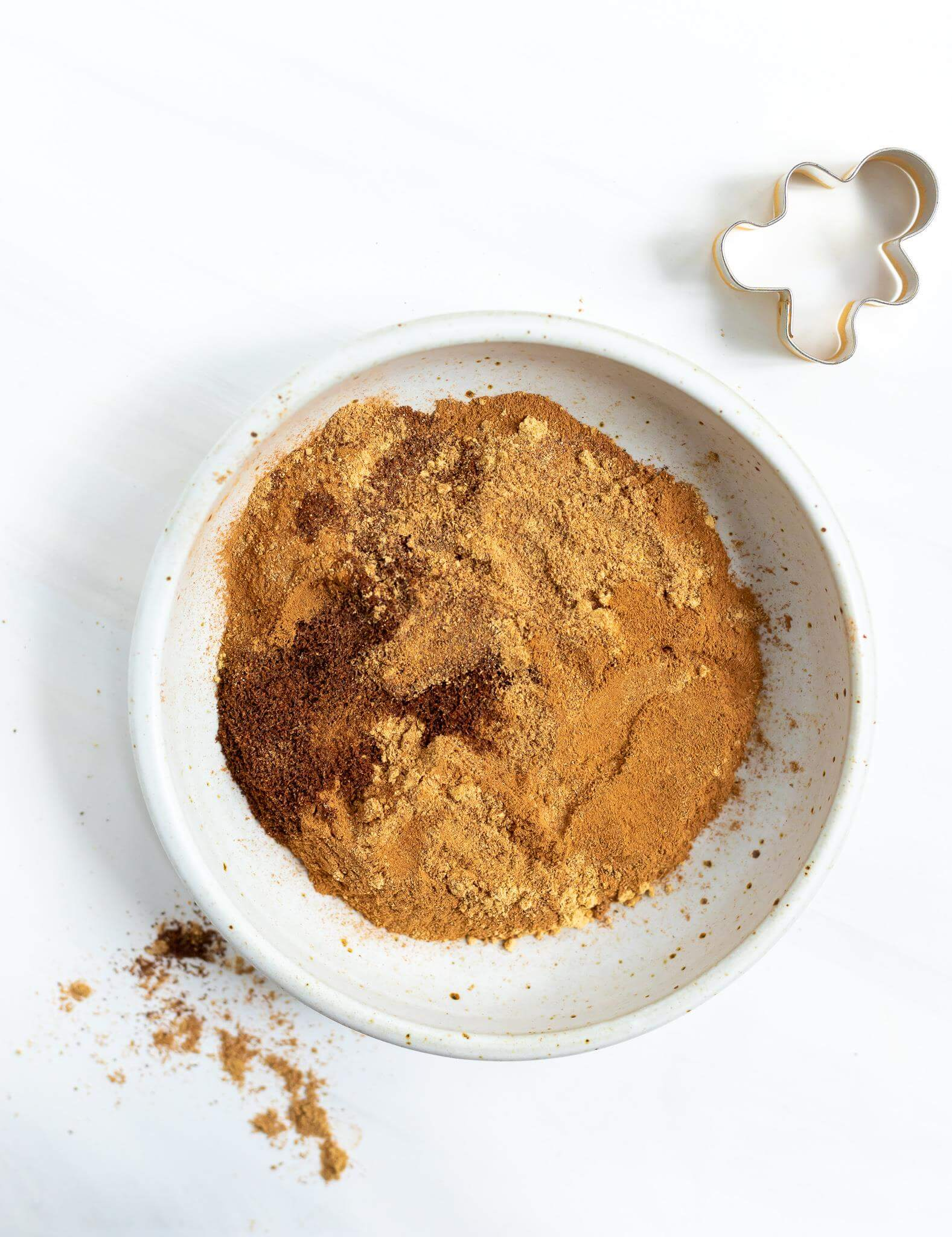 gingerbread spices in a white bowl