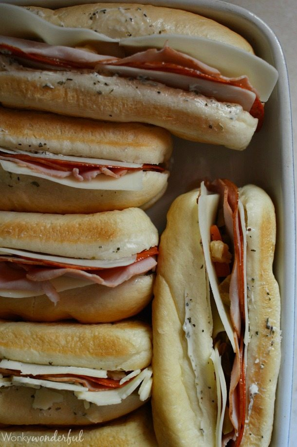 Hot Italian Sandwiches baked in the oven. Meaty Cheesy Sub Sandwiches, great for feeding a large crowd!