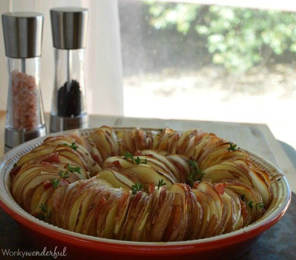 Roasted Potato Side Dish Recipe made with Roasted Garlic, Bacon, Thyme and Red Potatoes.