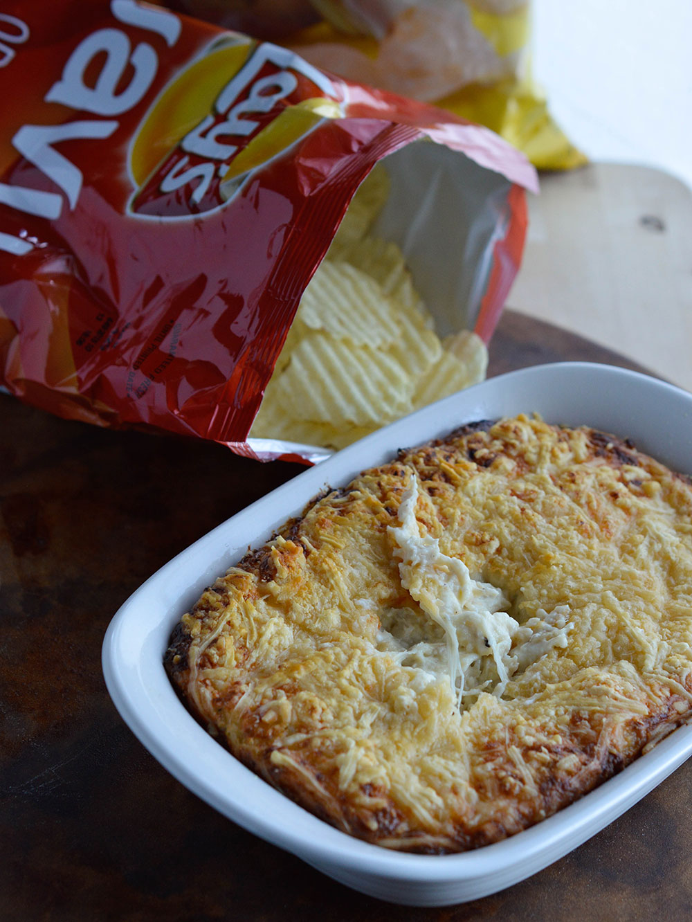40 Clove Garlic Chicken Dip Recipe - This unforgettable appetizer has an extreme roasted garlic flavor! Use rotisserie chicken and extra cheese in this easy dip recipe!