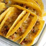 Oven Baked Tacos are perfect for feeding a crowd! This quick and easy taco recipe is full of flavor and melty cheese! Also a great weeknight dinner meal.