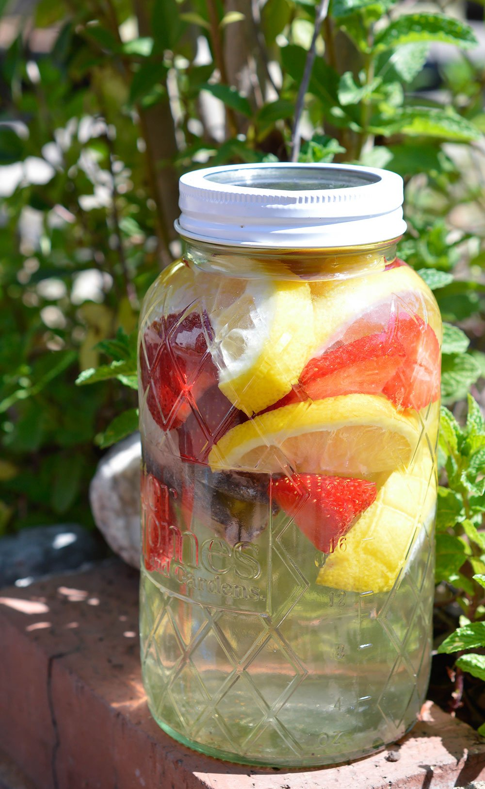 Strawberry Lemonade Sun Tea Recipe - This is the perfect summertime beverage. A naturally fruit flavored tea with no added sugar!