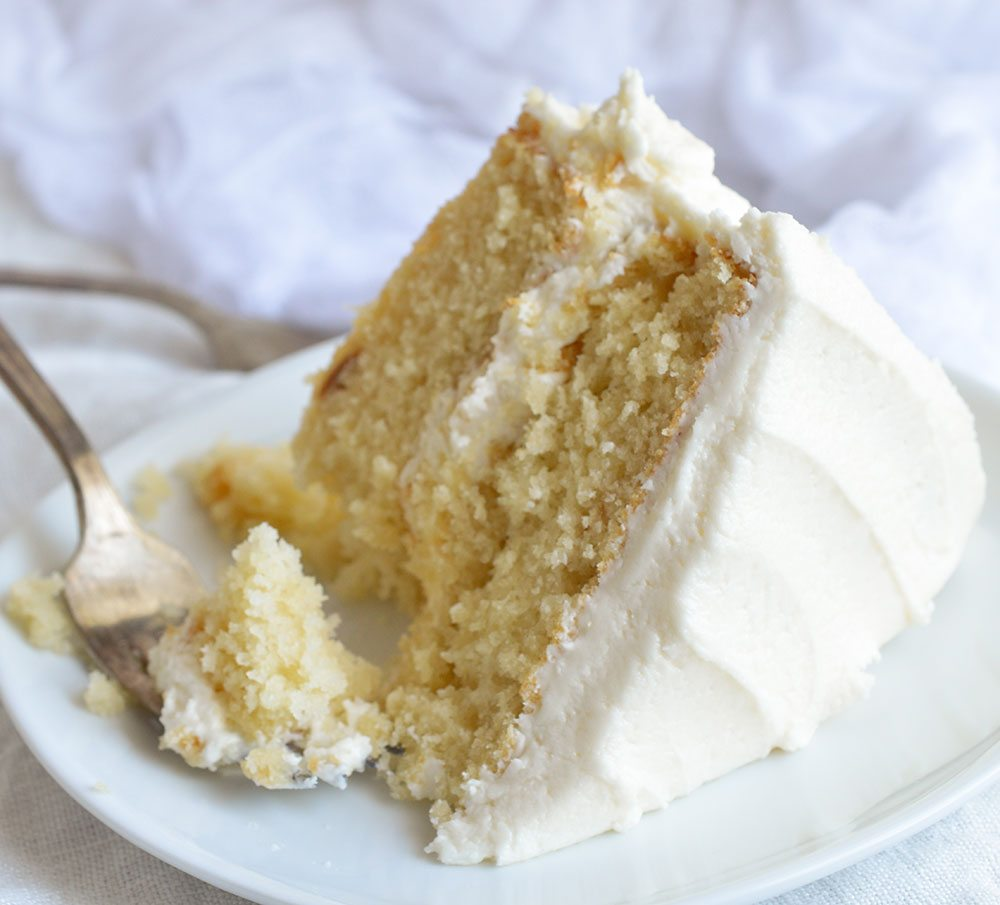 Bake a cake just like Grandma used to with this Vintage Buttermilk Vanilla Cake Recipe From Scratch. A delicate layer cake topped with homemade vanilla buttercream frosting!