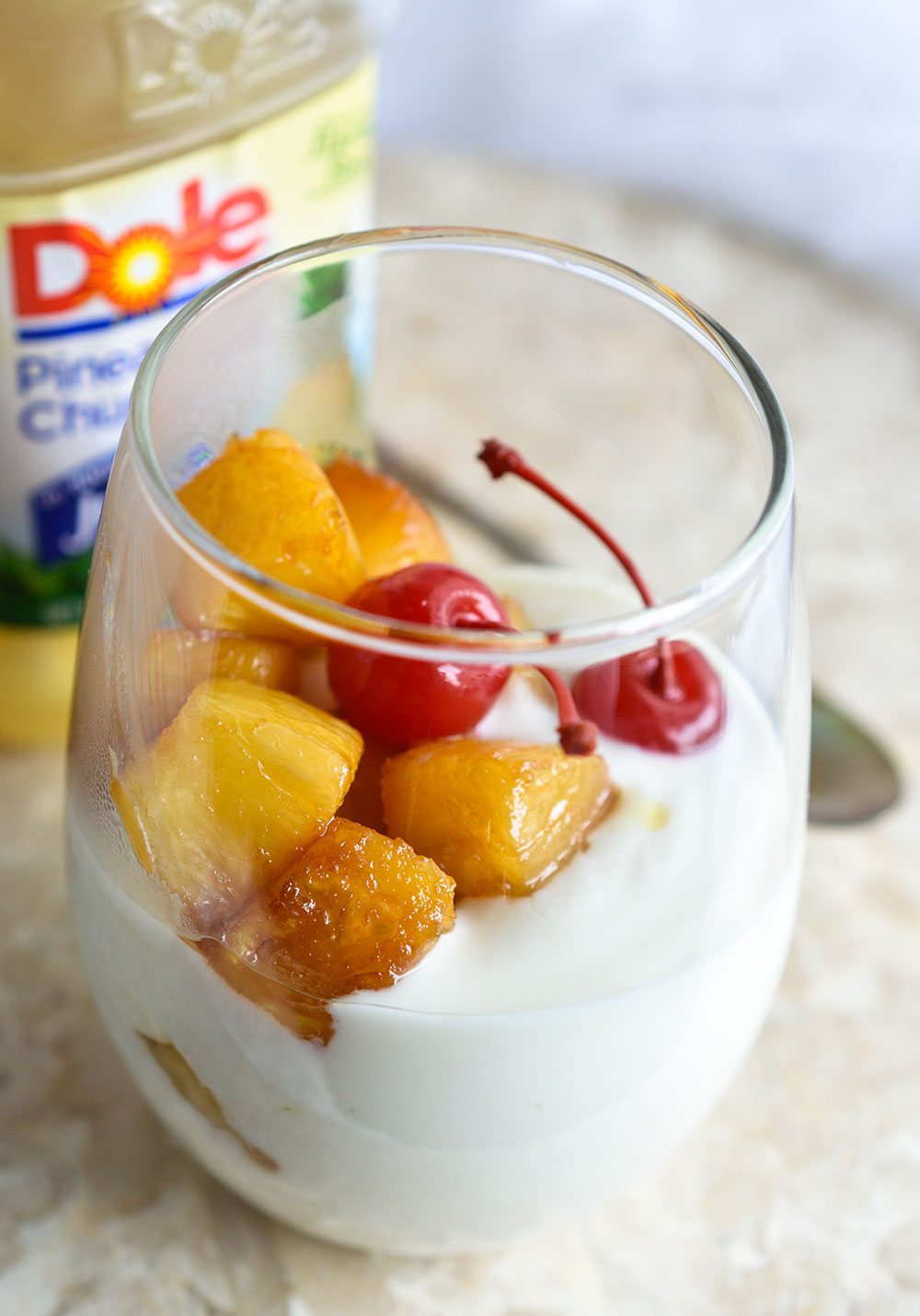 Make a Pineapple Upside Down Yogurt Parfait for a quick and flavorful snack or dessert! This sweet treat is less than 500 calories and comes together in 10 minutes or less!