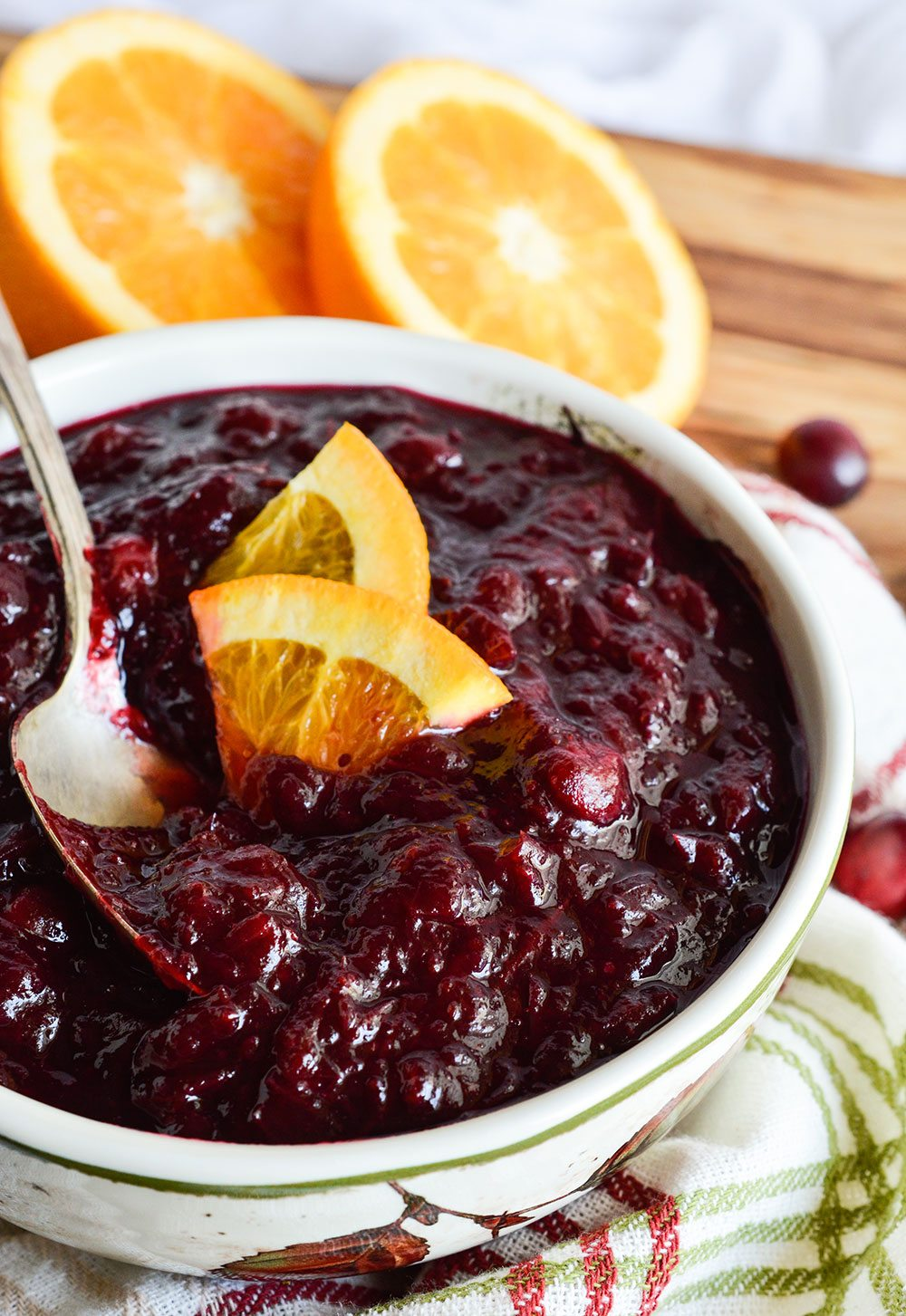 Slow Cooker Cranberry Sauce is an easy, no-fuss way to make this holiday favorite! Just mix ingredients, set your crockpot and move on with your life. Delicious, homemade cranberry sauce will be ready and waiting!