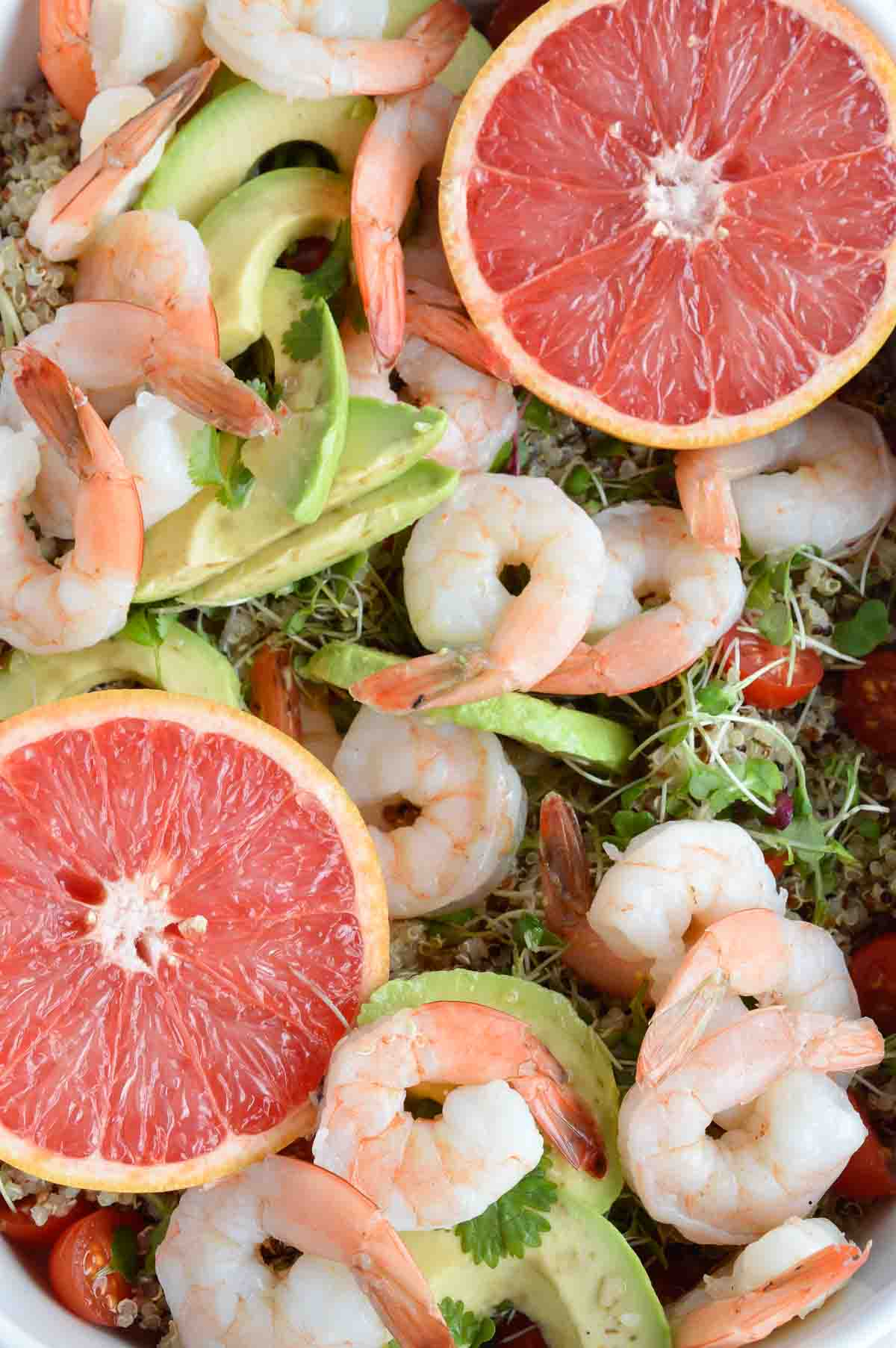 Shrimp Avocado Salad with Quinoa and Grapefruit Dressing is a bright, flavorful and healthy recipe! A simple salad made with boiled shrimp, avocados, tomatoes, quinoa, micro greens and homemade grapefruit vinaigrette.