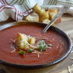 This Easy Tomato Soup Recipe is comfort food at it's best. San Marzano Tomatoes and roasted garlic take this family favorite to the next level! Enjoy a bowl of this healthy homemade soup for lunch or dinner.