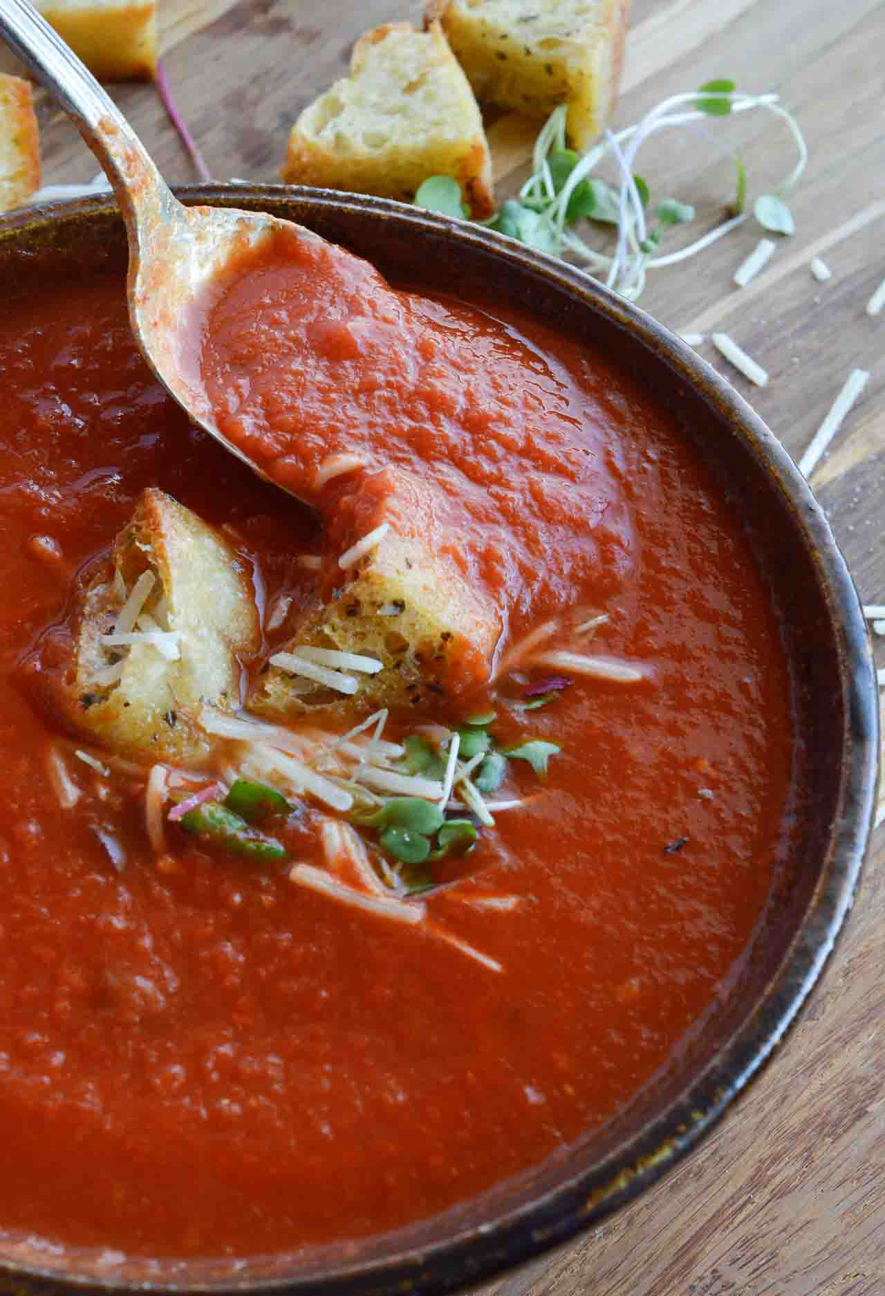 This Easy Tomato Soup Recipe is comfort food at it's best and just 3 ingredients! San Marzano Tomatoes and roasted garlic take this family favorite to the next level! Enjoy a bowl of this healthy homemade soup for lunch or dinner. And instead of sugar I use a secret ingredient to add a hint of sweet . . . spoiler, it is carrot juice!