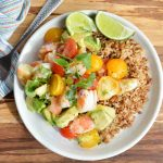Craving a bright and flavorful meal that id full of fresh ingredients? Make this healthy Avocado and Shrimp Salad Recipe for a nutritious and satisfying lunch or dinner! Serve this fresh avocado, tomatoes, lime, cilantro and shrimp on top of rice.