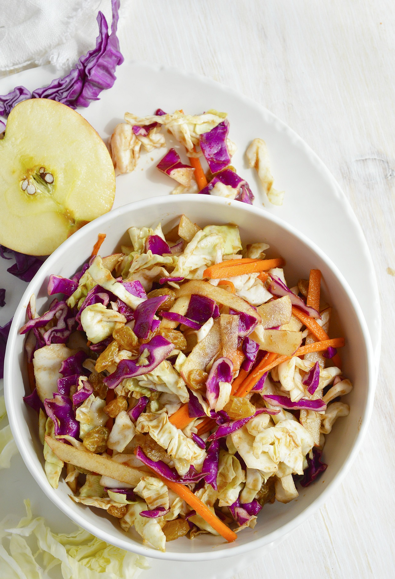 Try a unique twist on your favorite barbecue side dish. Instead of plain coleslaw make this Sweet and Savory Cabbage Apple Slaw! Red and green cabbage, carrots, apples, golden raisins tossed with a tangy apple vinegar dressing.