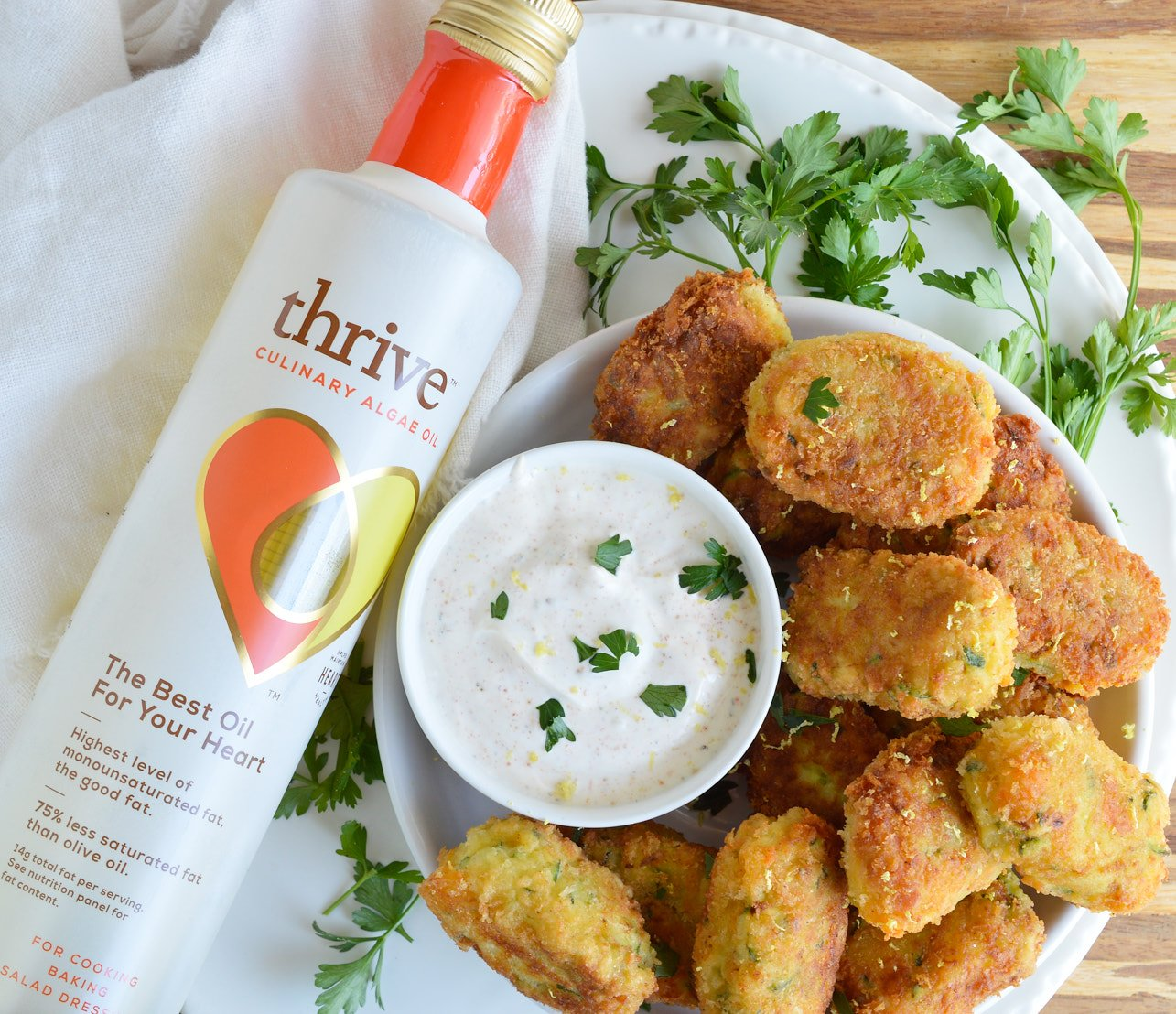 With the end of summer comes an abundance of fresh zucchini. Try this Cheesy Zucchini Tater Tots Recipe and that zucchini will be gone in no time! Cheese, zucchini and potatoes fried up into homemade tater tots.