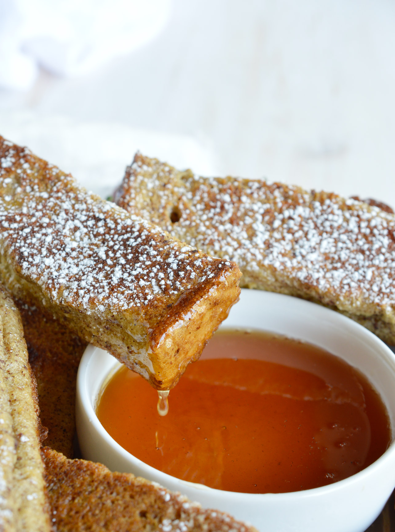 Breakfast and brunch just got a little easier with these Baked French Toast Sticks! This simple recipe is great for feeding a hungry morning crowd! Don't forget the maple syrup and coffee!