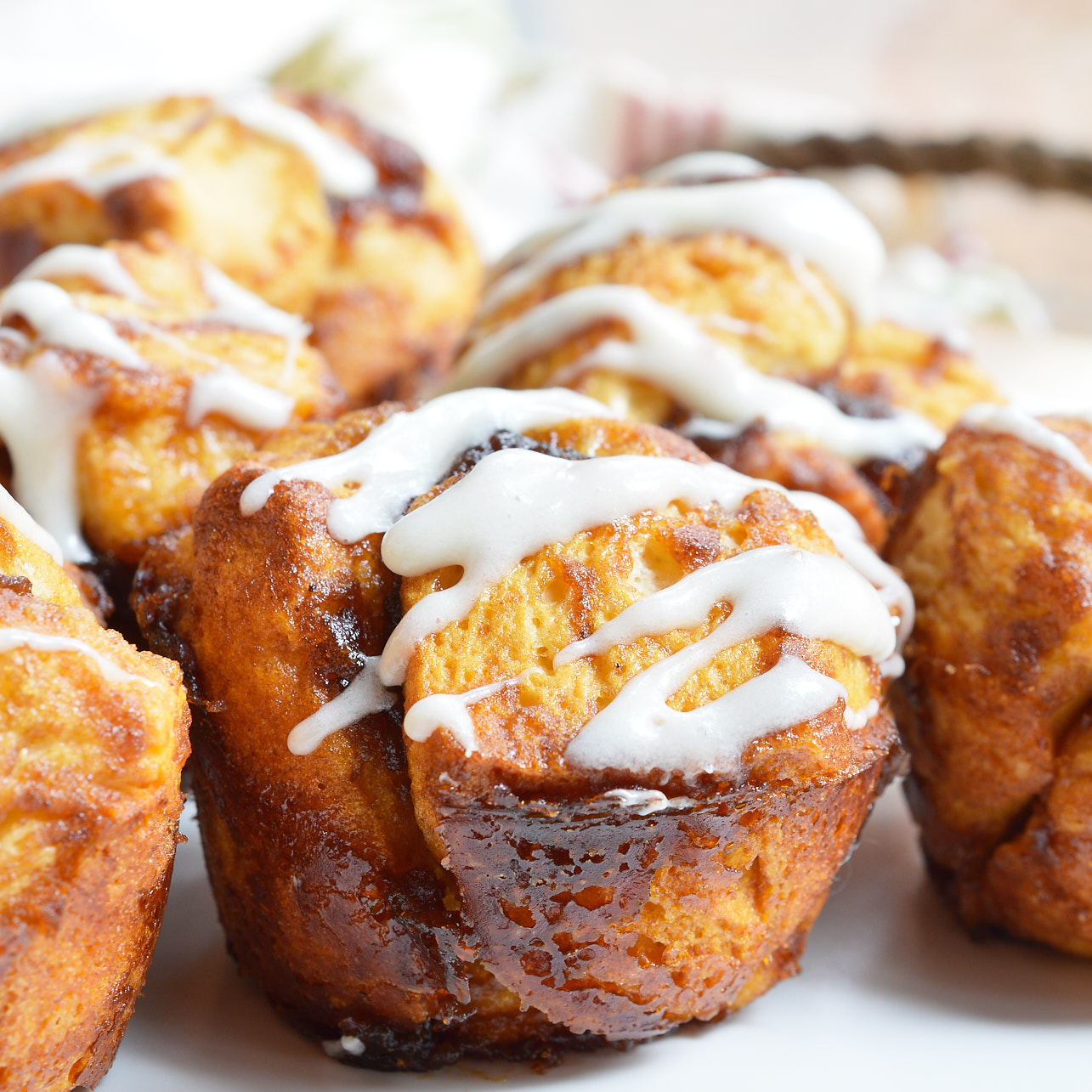 Need an easy breakfast recipe that will feed your hungry crowd? These Monkey Bread Muffins are made with just 4 ingredients and take no time at all! Like sticky buns with a cream cheese glaze without all the hassle.