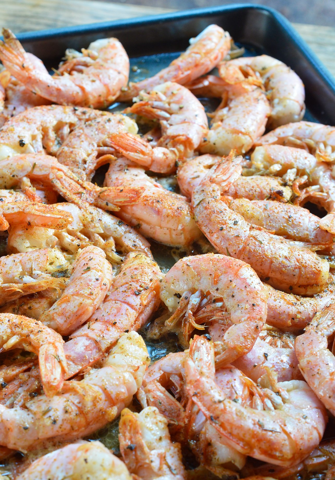 Oven Roasted Shrimp is quick, simple and delicious! This dinner or appetizer is swimming in butter, lemon and spices. Ready in 10 minutes!