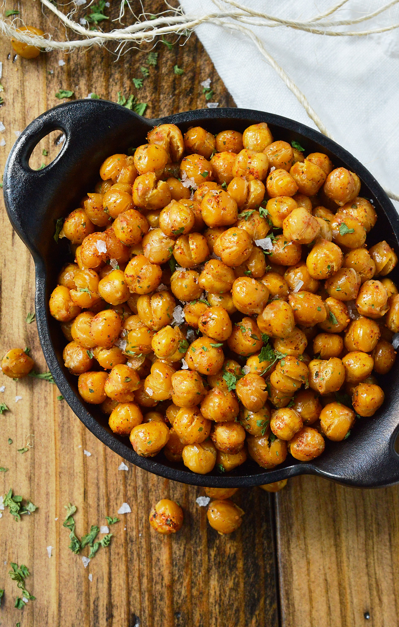 If you're looking for a healthy snack to satisfy that salty, crunchy craving, these Crispy Roasted Chickpeas are it! Learn how to toast chickpeas in the oven making them a nutritious high protein snack recipe. vegan, vegetarian