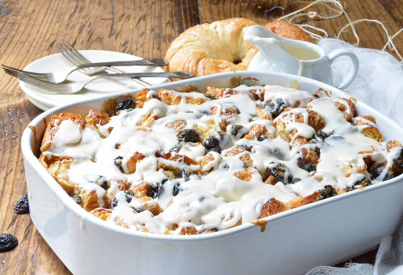 Go ahead and indulge your sweet craving with this Rum Raisin Croissant Bread Pudding Bake Recipe. Perfect for a dessert to feed a crowd or as an easy breakfast casserole.