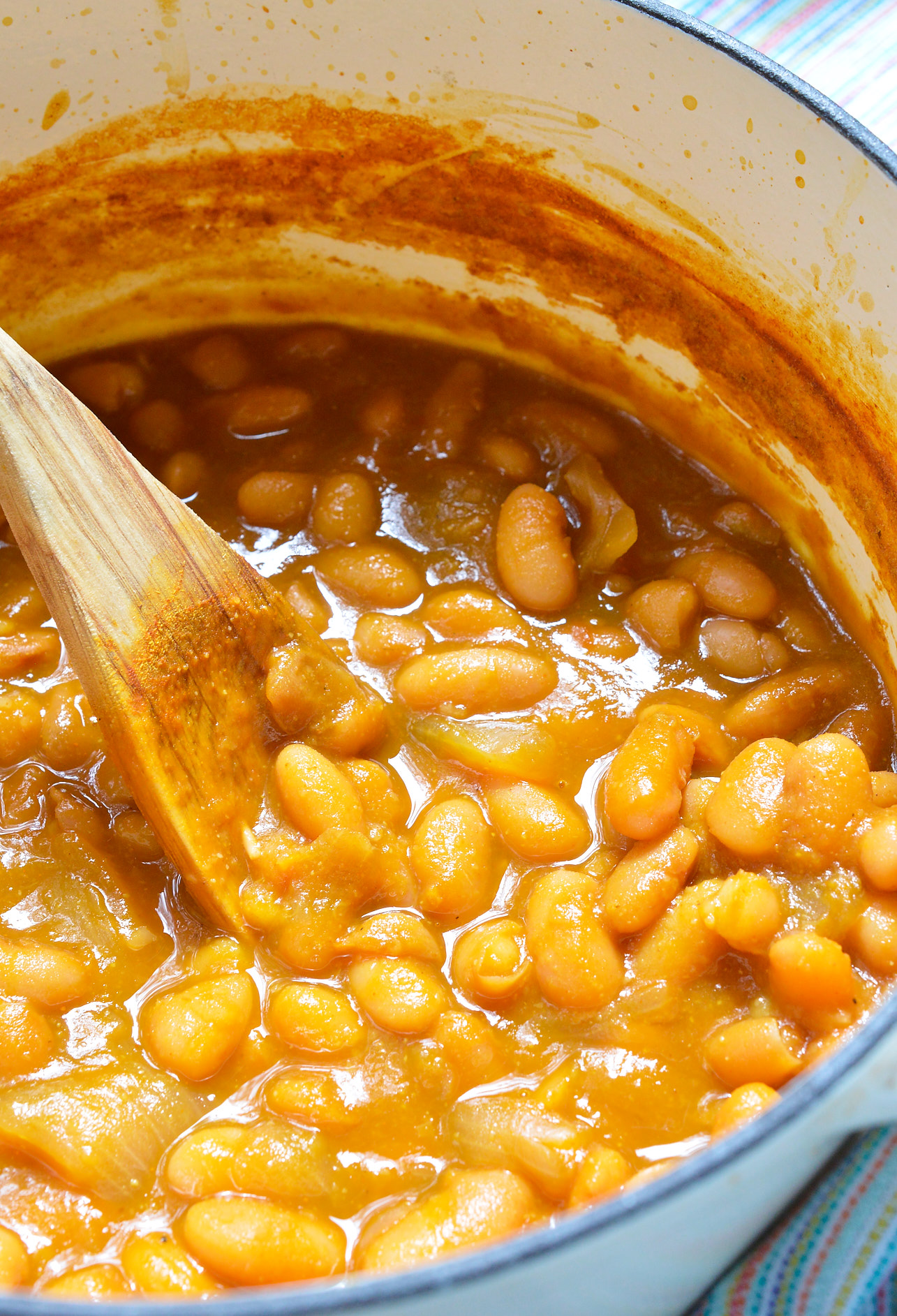 If you make this Refried Beans Recipe with Canary Beans you may never go back to the canned variety! This refried beans recipe is simple and produces the creamiest consistency thanks to the Canary Beans, also known as Mayocoba beans. These Peruvian beans are similar to pinto beans and taste great with any of your favorite Mexican dishes! vegetarian and vegan options included