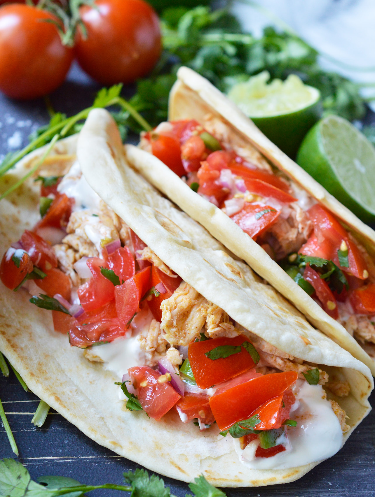 Start the summer off right with Fresh Homemade Pico de Gallo Recipe that is spiked with Tequila. Perfect for a party appetizer or a tasty snack by the pool!