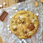 This fun twist on your favorite cookie is filled with S'mores goodness. S'mores Chewy Chocolate Chip Cookies make a great summertime dessert that can be enjoyed inside or outside! Marshmallows, chocolate and graham crackers make this super chewy cookie recipe extra special.