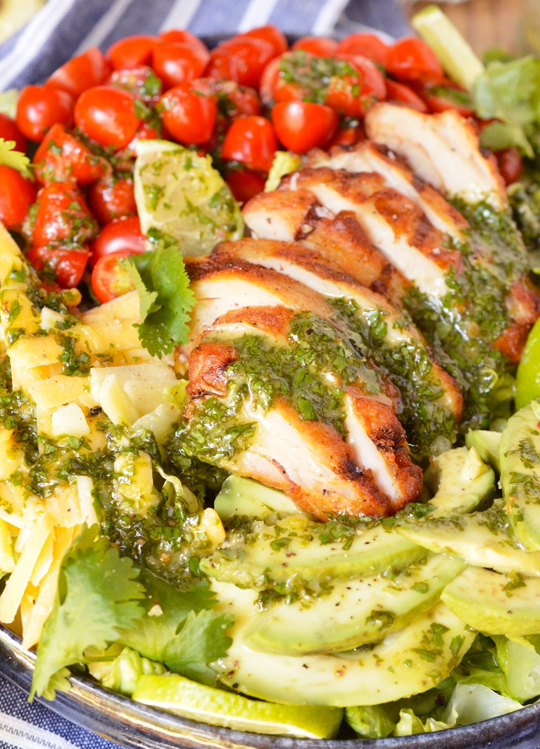 For a quick, fresh, easy and nutritious meal look no further than thisGrilled Chicken Salad with Cilantro Lime Dressing. Romaine lettuce topped with tomatoes, avocado, cheese, grilled chicken and cilantro lime vinaigrette... this is an easy dinner recipe that you can feel good about!