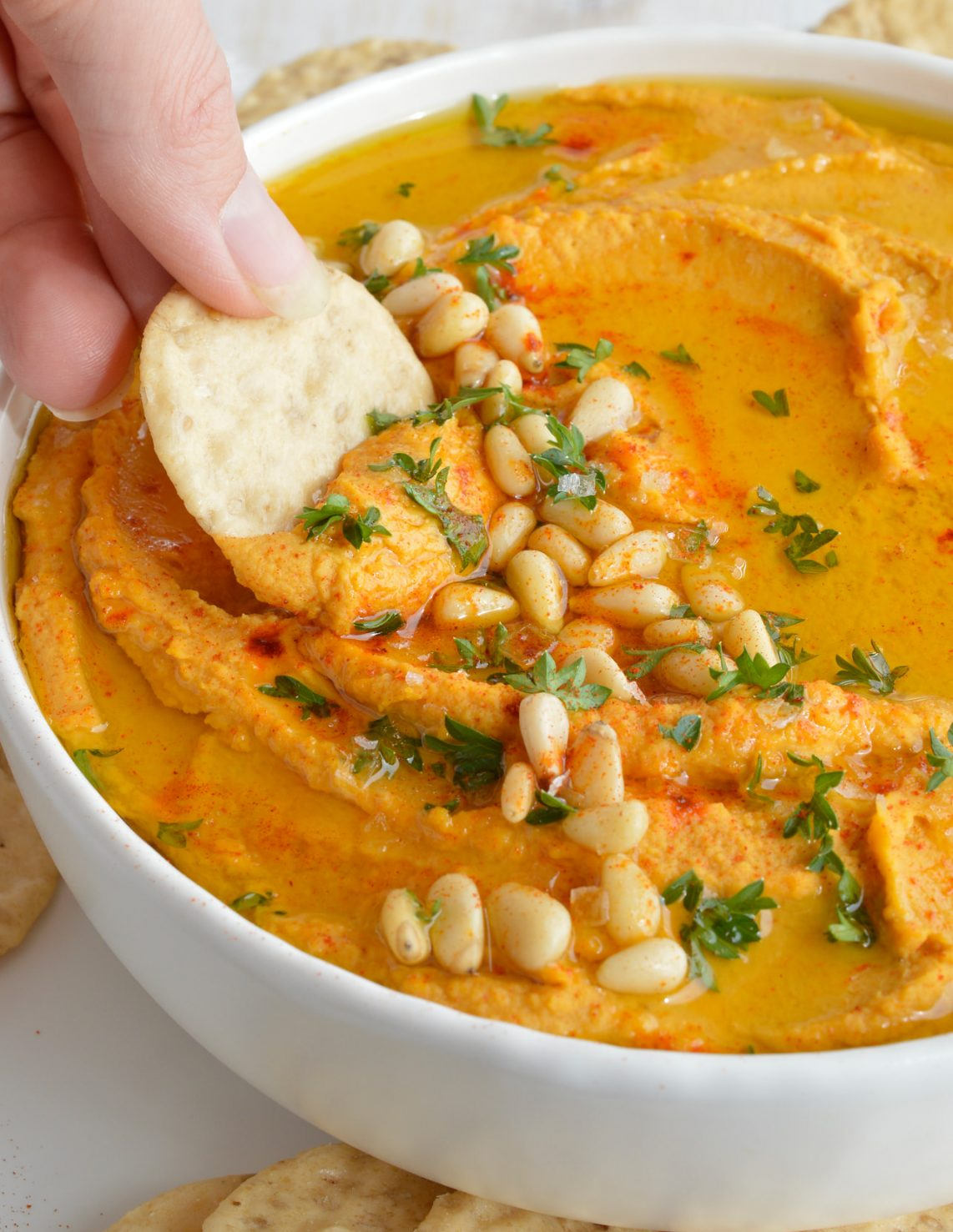 This Pumpkin Hummus Recipe needs to be on your holiday menu! This hummus is super creamy, full of flavor and great for feeding a hungry crowd! The perfect healthy dip recipe for Thanksgiving.