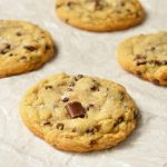 These Soft Chocolate Chip Cookies are my family's favorite treat! A special secret ingredient gives them a unique flavor and they are loaded with two types of chocolate chips! Also, this is a High Altitude Chocolate Chip Cookies Recipe. Soft, chewy, super-chocolaty and finished with a sprinkle of sea salt.