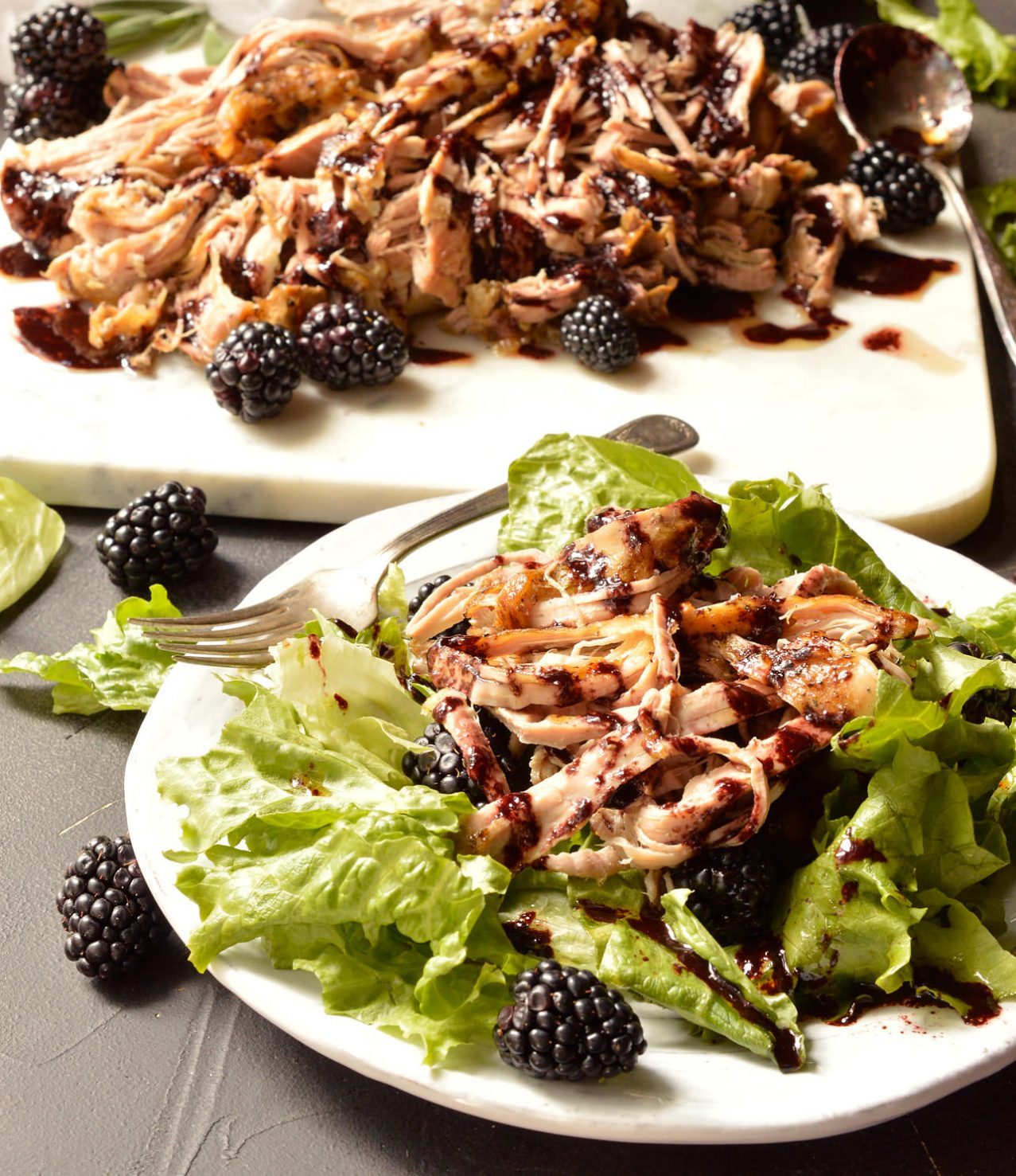 For a simple yet unique pork dinner recipe, look no further. This Slow Cooker Pork Tenderloin is fall apart tender and topped with a vibrant Balsamic Blackberry Sauce. Serve this over a fresh salad for a Whole30 Paleo compliant meal. If you are not following a special diet this shredded pork is great on sandwiches or tacos! #whole30recipes #paleo #porktenderloin #slowcooker