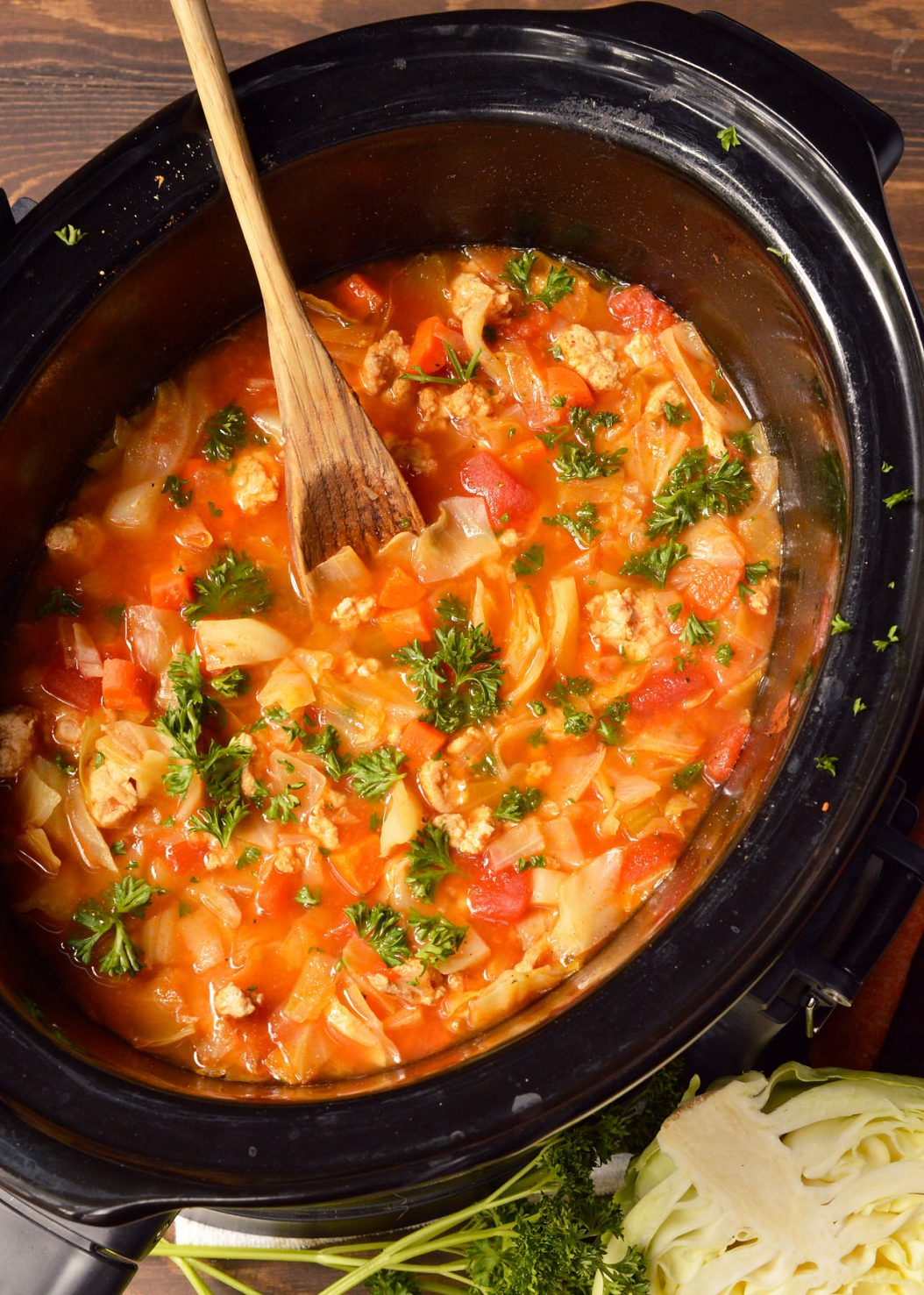 Keep warm and cozy with this Slow Cooker Cabbage Roll Soup. This soup recipe is easy, filling and healthy! Just toss a few simple ingredient into your slow cooker and dinner will be waiting for you. This is a Whole30, Paleo compliant recipe. #whole30recipes #paleorecipes #whole30 #paleo #cabbagerolls #slowcooker