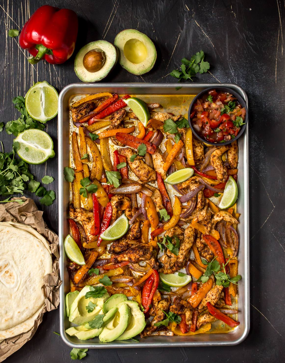 Sheet pan chicken fajitas paleo whole30 wonkywonderful overhead photo of chicken bell peppers and limes in sheet pan tortillas limes forumfinder Gallery