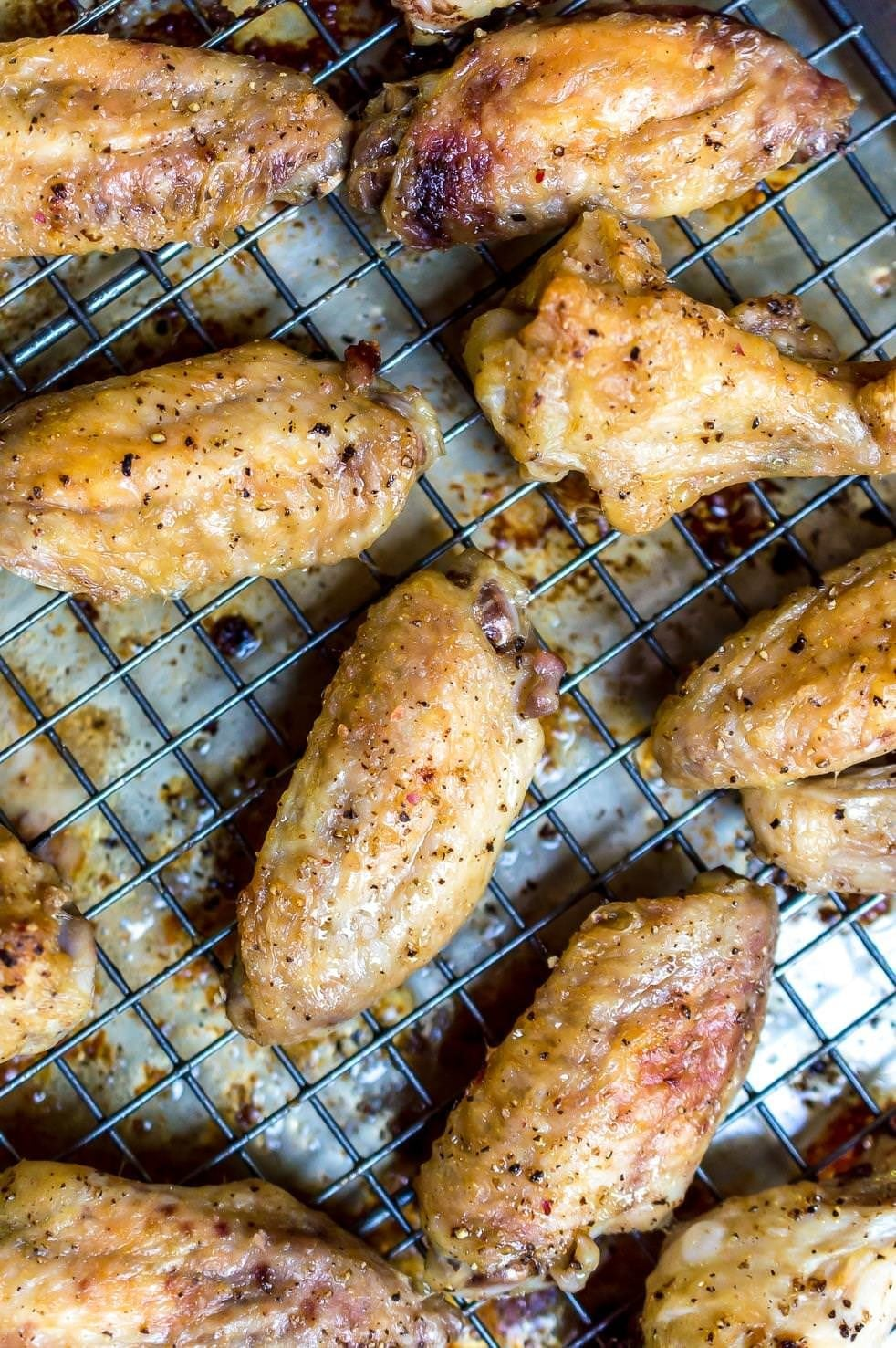 Oven Baked Chicken Wings are the ultimate party food! They are quick, easy, inexpensive and great for feeding a crowd. Plus, you can flavor however you like. These Chicken Wings with Cilantro Garlic Chimichurri are a fun new way to serve party wings! This is a Whole 30 Paleo compliant recipe, grain free, gluten free and dairy free. #whole30recipes #paleodiet #glutenfreerecipes #dairyfreerecipes #chickenwings