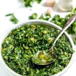 Add a punch of flavor to your favorite Summer grilling recipes with this Roasted Garlic Cilantro Chimichurri Sauce! This bright green cilantro chimichurri recipe is fantastic on burgers, chicken, steaks and more. And this is a Whole30 Paleo compliant recipe, gluten free, grain free, vegan and dairy free. #whole30recipes #paleodiet #chimichurri #cilantro