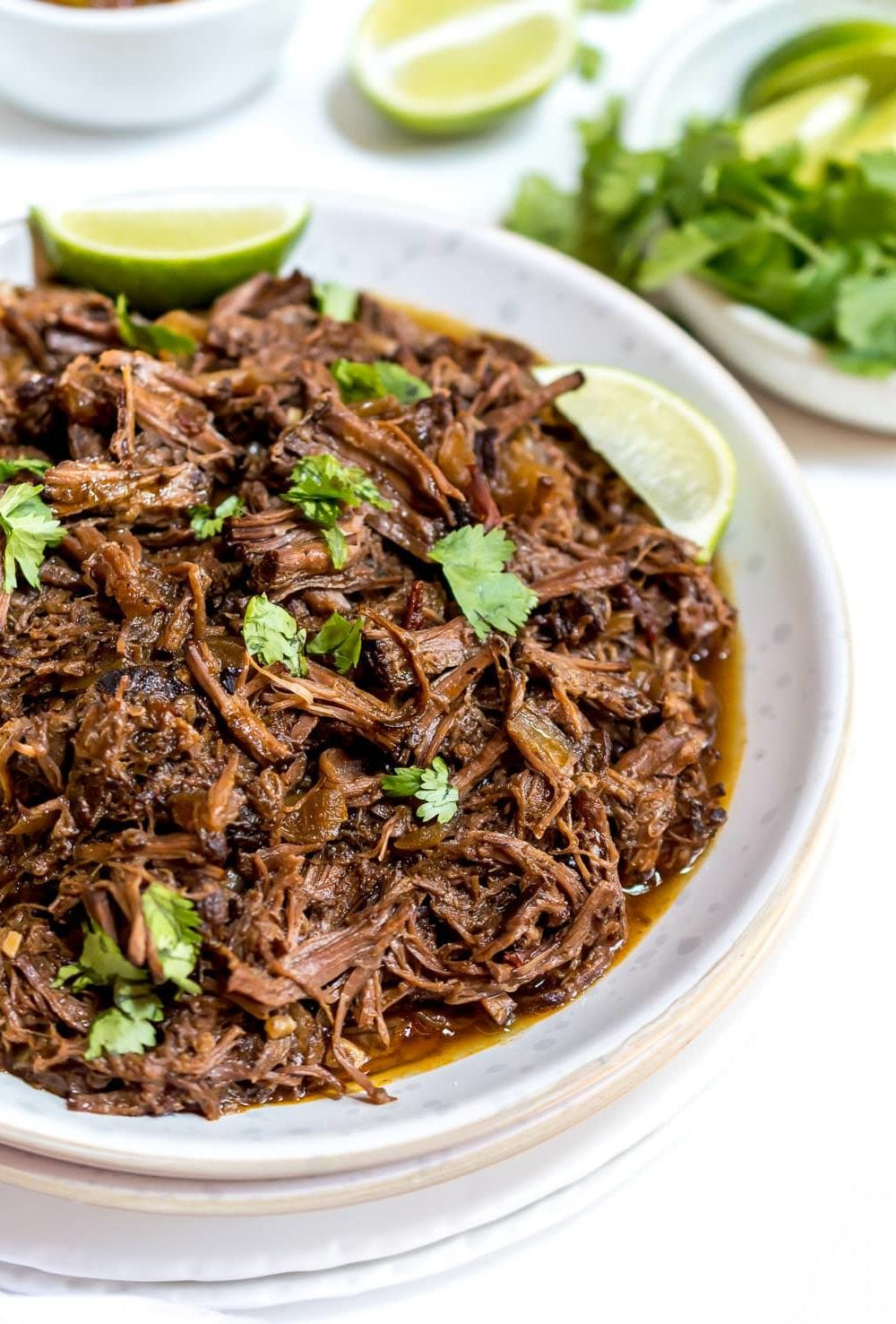 This Cherry Chipotle Slow Cooker Barbacoa Recipe is the perfect meal to serve to family and friends this summer. Keep entertaining easy with this flavorful crockpot recipe. The tart cherry and chipotle combo make this unique dish unforgettable. This recipe is Paleo compliant, dairy free, gluten free and great for meal prep. #slowcookerrecipes #paleorecipes #whole30recipes