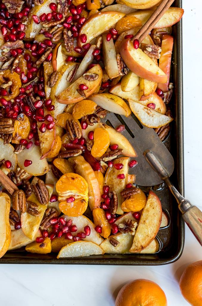 baked apples, pears and mandarins on a baking sheet
