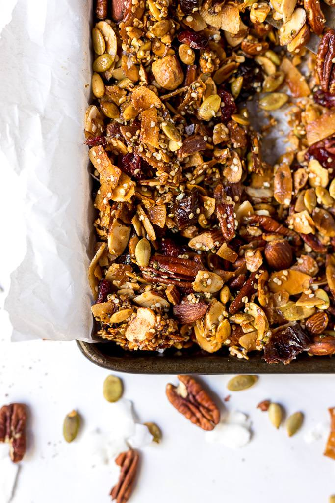 paleo granola in baking sheet lined with parchment paper