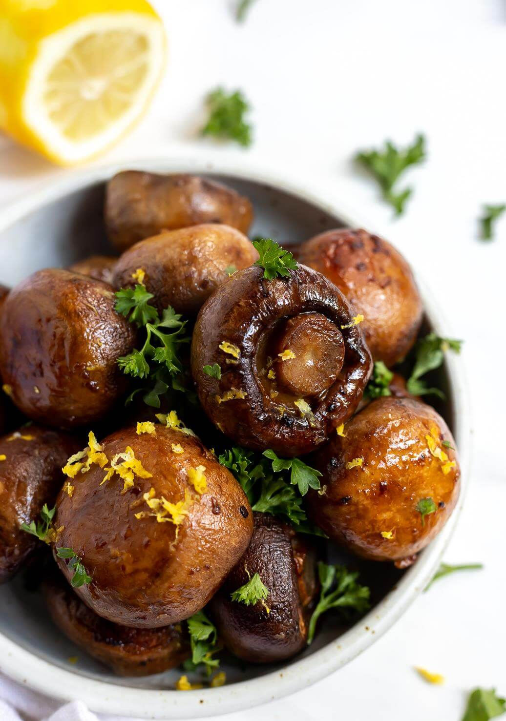 brown roasted garlic mushrooms topped with parsley and lemon zest