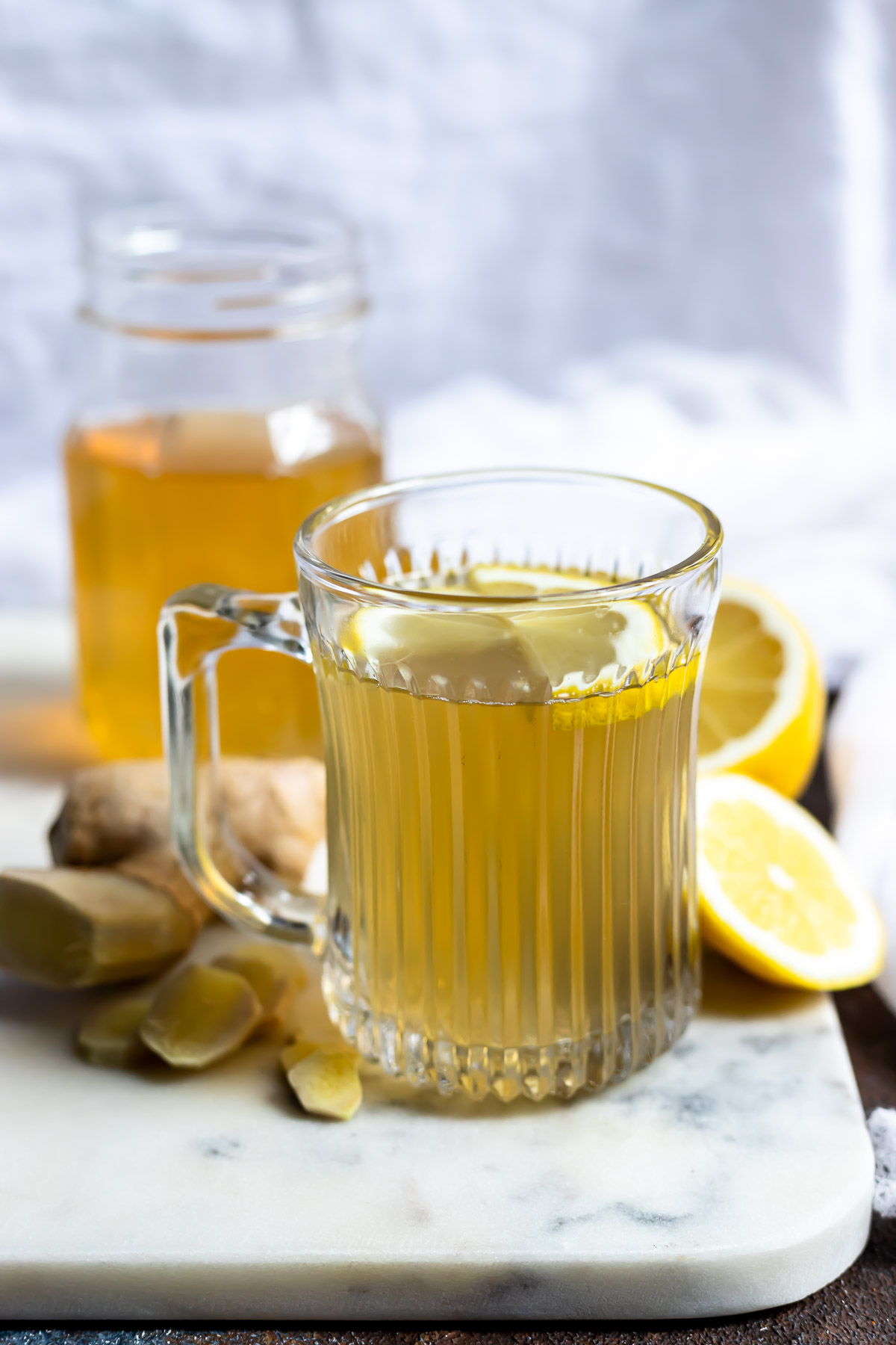 ginger tea in clear mug with lemon slices showing the benefits of ginger