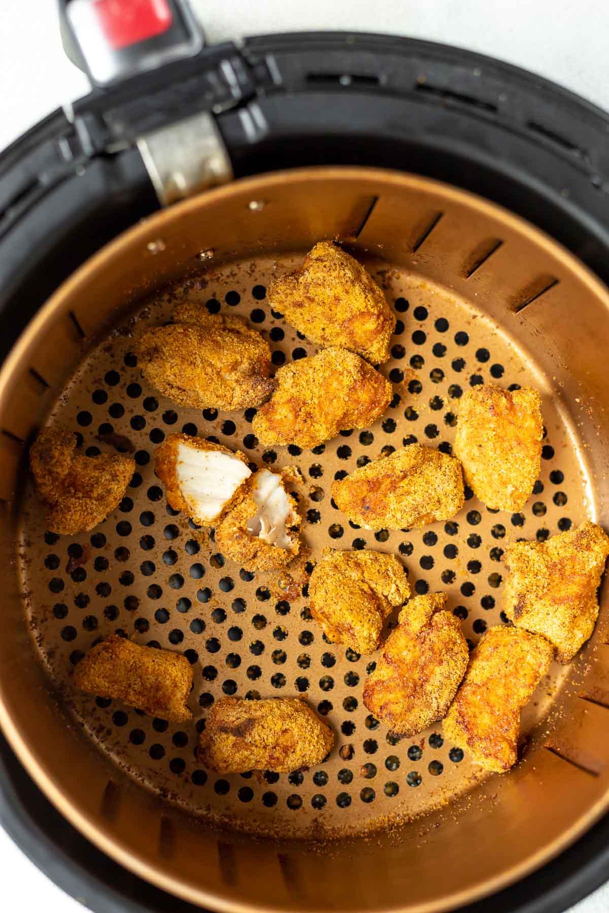 air fryer chicken nuggets in fryer basket
