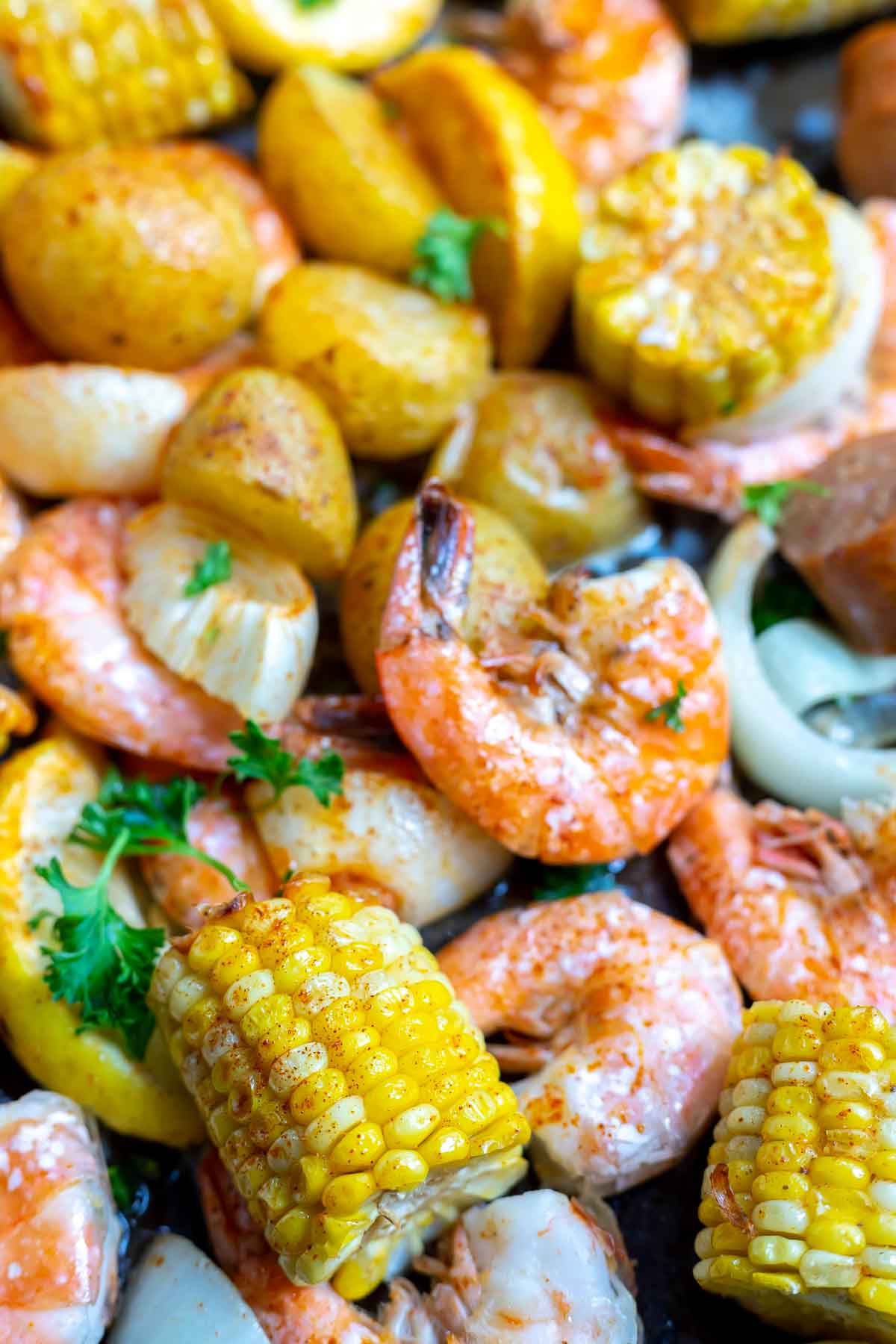sheet pan shrimp boil ingredients on pan