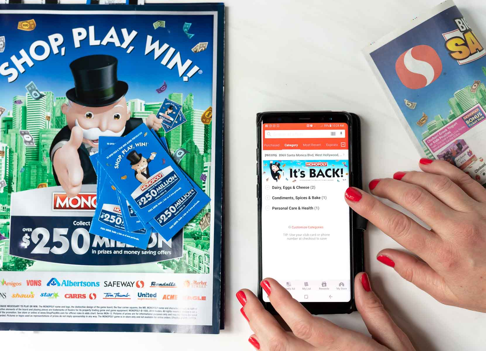 safeway ad next to smart phone with safeway savings app