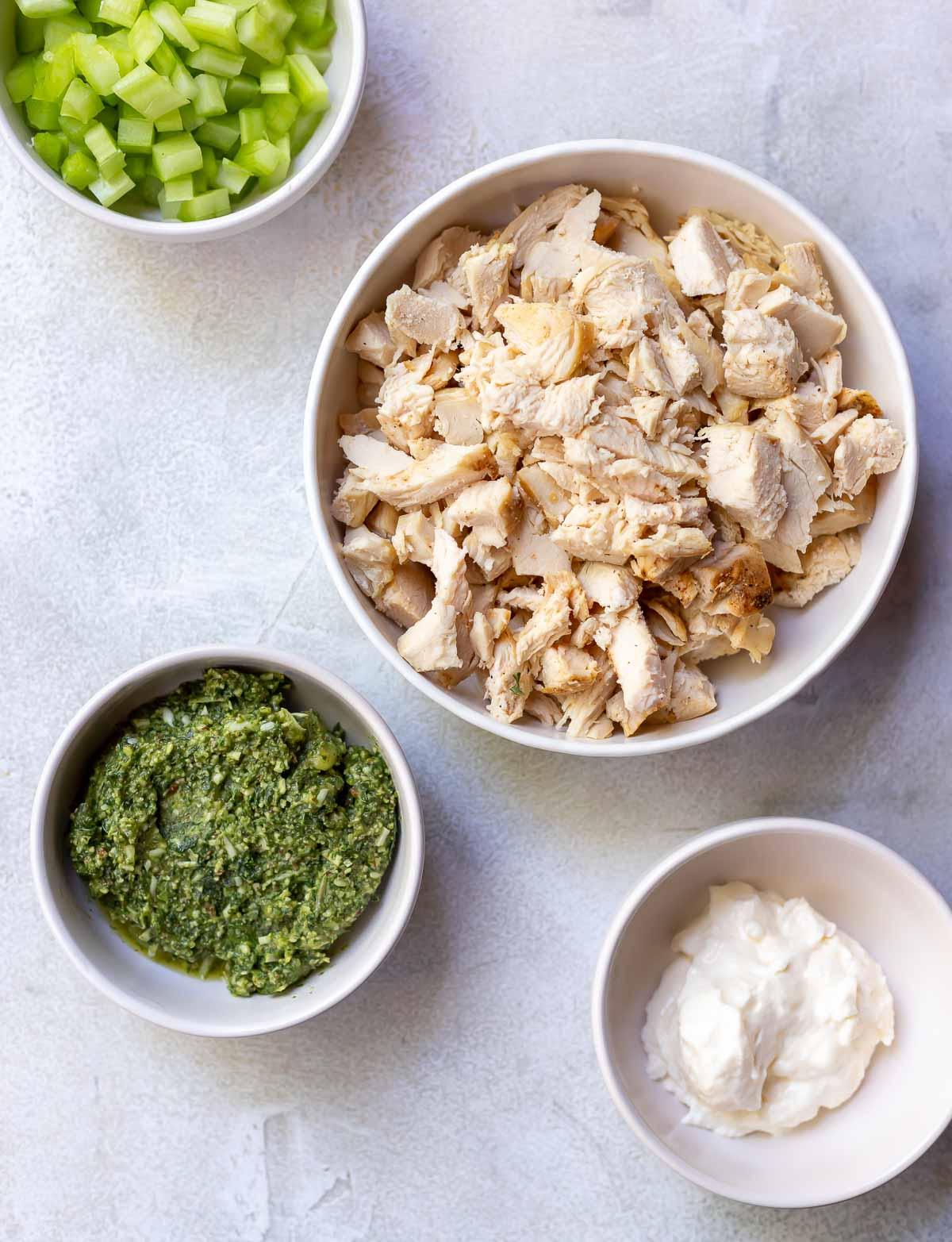 ingredients for chicken salad recipe in white bowls